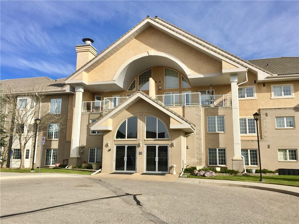 Top floor unit with 1 bed 1 bath in the Sierra's Of Country Hills 55+ complex. Open concept layout offers 9? ceilings & air conditioning.  Kitchen features loads of cabinet/counter space while the living room is cozy with a gas fireplace.  Spacious bedroom, 4pc bathroom & large laundry room complete the unit.  Sunny southwest facing balcony with gas line is perfect summer lounging & BBQs. The unit comes complete with secured heated underground parking stall and large storage locker.   Building amenities include swimming pool, exercise room, pool tables, workshop, party room, library & carwash. Walking distance to shopping & transit. Building is well managed & in a fantastic condition. Condo fees include all utilities (heat, electricity & water).