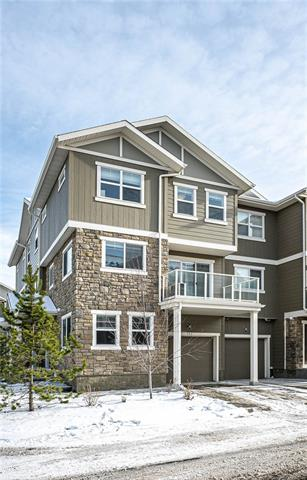 """Open House: Saturday, Nov,16.1-3pm.TOWN HOUSE WITH 3+1BEDROOMS IN GREAT PRICE!!FORMER SHOWHOME, Certified BUILTGREEN. The End model is a fully finished townhome with 3 Beds, 2.5 Baths PLUS Flex Room, SINGLE ATTACHED HEATED GARAGE with full driveway for a 2nd vehicle! You'll love the fantastic OPEN FLOOR CONCEPT, Quartz countertops with undermount sink in the Kitchen AND Bathrooms, UPGRADED appliance package, splatter coated ceilings, rounded corners, 2"""" Faux Wood Blinds, beautiful wide plank laminate flooring, and contemporary finish throughout! Built-In surround sound, A/C unit and much more. The maintenance free exterior with durable Hardy Board and stone accents, a large balcony, greenspace, parks and onsite Child Care Facility (Kids & Company). Close to transit, shops, new schools, Stoney Trail and more!"""