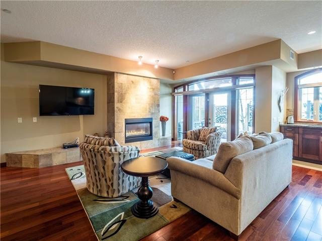 VERY RARE THREE bedroom, TWO titled parking stalls, upscale finishings, that SHOWS LIKE NEW. QUICK POSSESSION available! Convenient location, across from the Calgary Winter Club. This is your opportunity to own this beautiful extra-large condo, in a great location. Perfect for entertaining with a very open floor plan, 9-ft ceilings, exotic Pengali Ironwood floors, solid mahogany doors, central air (of course), and Conematic hot water heating. Kitchen features amazing Lyptus wood cabinetry, granite counters, and top-of-the line appliances including Miele and Jenn-Air fridge. Extra-large master features a stunning ensuite with oversized walk-in shower and double sinks, plus a walk-thru closet with built-ins. Other features include three private terraces, with custom privacy screens, custom window blinds, and a very large laundry/storage room with side-by-side Miele washer and dryer. All of this can be yours, with a quick possession. Call today to fully appreciate all that this property has to offer.