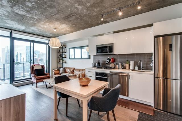 """Welcome to downtown living! This dreamy 1bed/1bath apartment offers a modest & manageable space to call home. Imagine waking up in the morning with your head in the clouds, with views of Calgary's sunrise from the 24th floor. Make breakfast, lunch, and dinner in your crisp, white kitchen over your gas stove. The quartz countertops glossy cabinets give the space a clean & simplistic finish. Pent up stress? Head to the 2nd level for a workout in the fitness facility, or go for a swim in the outdoor pool. Wrap up your day with a cup of tea on your 9'10"""" x 6'4"""" balcony, and enjoy Calgary's cityscape. Or enjoy a cozy night of Netflix nestled in the comfort of your open-concept lifestyle room."""