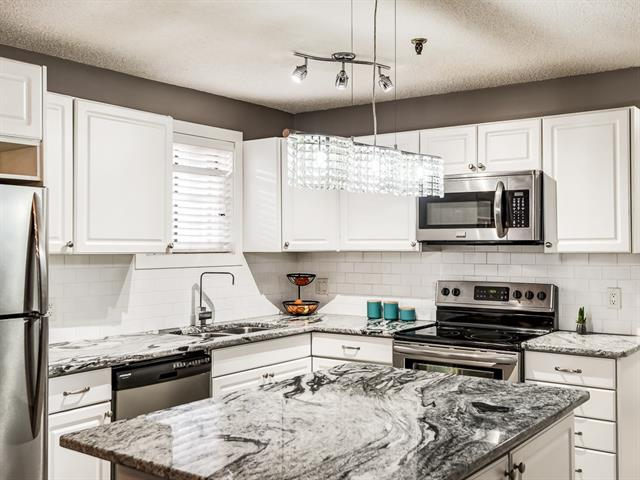 Unbeatable LOCATION & Incredible Value! This fully renovated condo comes with a fresh new kitchen including granite countertops, under-mount sinks, & gorgeous stainless steel appliances. The open concept living space is bright, spacious and extremely functional. This home feels MUCH larger than what you'd expect. The chef's kitchen is perfect for entertaining with a large central island (moveable) that overlooks the designated dining and living room. The master is located at the other end of the unit and is massive! It offers two large closets and plenty of space for an office space or seating area. This end unit offers newer porcelain tile, & laminate flooring throughout, updated bathroom, new lighting fixtures, newer doors, 2-entryways, a private deck, in-suite laundry, secure heated underground parking, & a storage locker. It's a quick commute to downtown, Marda Loop, shopping and walking distance to 17th Ave w/ transit close by. If you want turn-key, this is it! Flexible possession is available.