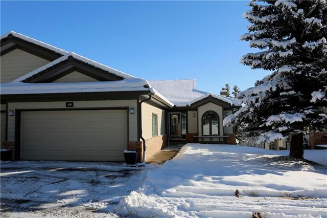 *** Open House*** Sat Feb 8, 1-3. Welcome to Priddis Greens! Backing onto Reserve Land with an Unabstructed Valley View this Renovated Walk Out Bungalow offers a Serene Lifestyle! Features include over 2900 SqFt of Living Area, New Hardy Board Siding, Full Upper Deck and Lower Patio, 3 Bedrooms (one made into an office), 3 Full Baths, Open Kitchen with Custom Cabinets, Granite Countertops, Gas Cooktop, SS Appliances, Walk In Pantry, Hardwood Floors, Main Floor Laundry, Programable Underground Sprinklers, the Double Attached Garage is Insulated and Drywalled large enough for 2 Cars and a Golf Cart. Come See It today. It is Live In Ready!!!