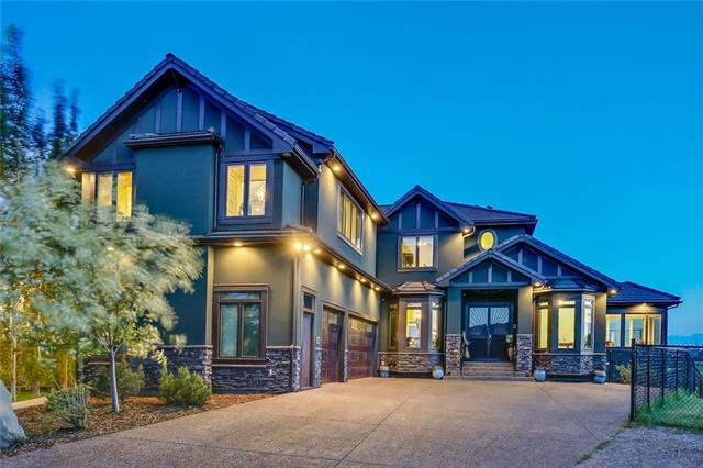 Majestically situated overlooking the North end of the lake, boasting over 5600 square feet of developed living space! Custom designed and crafted with incredible attention to detail and no expenses spared! Timeless and elegant details such as coffered ceilings over the great room, wainscotting in the dining room, and faux stone walls in the interior matching the exterior stonework! This is a dream kitchen with the large 6 burner Wolf gas stove, custom hood range, the Sub Zero fridge with matching cabinet doors, wine fridge, 2 copper sink stations and a Miele coffee station for the coffee connoisseurs! With the 25 foot pantry you will always have enough storage! The double sided stone fireplace adds ambiance! There is a guest bedroom and an office on the main floor with direct outside access! Perfectly postured for an at home business the upstairs bonus room has exterior access, a 2 piece bath, an elevator, is sound proofed and constructed to hold the weight of 75 people and 2 Grand Piano's! continued...