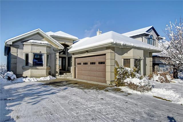 Premium ridge executive bungalow. Truly some of the best views in the city! Unobstructed, panoramic views of the mountains, river and city. Stunning, immaculate, walkout bungalow featuring 10' and 12' ceilings throughout, re-finished hardwood flooring, gourmet kitchen with newer stainless steel appliances, huge island and granite counters, lovely open great room, main floor den, infloor heated garage and fully developed walkout basement with infloor heat. Other upgrades include Hunter Douglas Silhouettes, Rollco Shutters, central air and newer shingles. This is a one of a kind home and view!