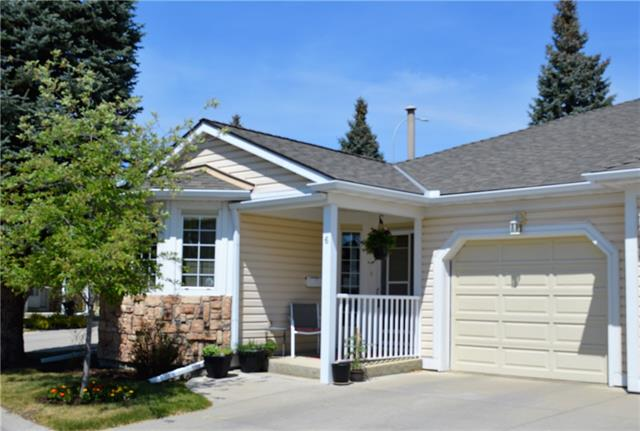 OPEN HOUSE SUNDAY 12 JAN 11 - 1PM  Unbelievable price for this well located UPDATED, AIR-CONDITIONED BUNGALOW VILLA located steps away from golf club house, Bow River pathways, shopping and transit in popular Douglasdale Estates.  Home has 1700sf of developed living space.  The 1100sf main floor features TWO bedrooms and TWO full 3-PC bathrooms, a large kitchen with breakfast nook, spacious dining room, and living room with gas fireplace and glass patio doors to fenced private deck.  Lower level has 600sf of development with THIRD bedroom and a 4-PC bath, large recreation room and plenty of undeveloped storage space / utility room. Updates include two completely new 3-PC bathrooms and knockdown ceilings (no more popcorn) on main, plus new baseboards, paint, light fixtures and custom blinds throughout.  SINGLE attached garage plus second parking space on driveway. Well run Adult (18+) condo complex is pet friendly.