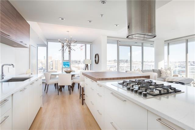 WOW!!A stunning 3 BEDROOM PENTHOUSE in LIDO with incredible, unobstructed views! Located in the heart of Kensington, a block from downtown core,steps from trendy shops,restaurants, river pathways, groceries,and C-train.The open concept condo is infused with natural light from wall-to-wall and floor to ceiling windows. Sleek modern finishes including European resilient flooring create a chic loft-like feel.The kitchen sports white cabinets,quartz counters, stainless appl and an extended  island that is perfect for entertaining.The spacious master suite is very private with lots of closet space and 4pc ensuite. On the opposite side of the condo, find two large bedrooms that can also function as a office/den and a second full bath and spacious laundry. There is loads of storage throughout and a separate storage locker!! In addition to the beautiful balcony off your living room, enjoy the private roof-top patio with fireplace. Included is 2 titled,underground parking stalls and plenty of visitor parking.
