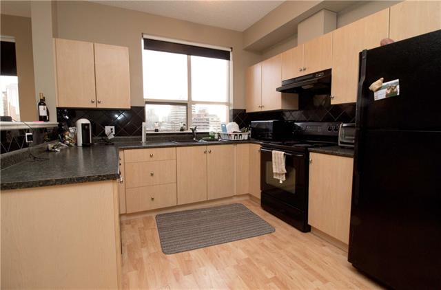 Awesome condo with a view of downtown. Great location with close proximity to shopping and restaurants, the Downtown West/Kerby free zone Ctrain station, and a shortly walk to 17th Ave and Stephen Ave.  This beautiful well one bedroom features a open concept with lots of natural sunlight, contemporary finishing, a 4 piece bath, balcony, in-suite laundry, titled heated under ground parking, workout gym on the 2nd floor, Co-op grocery across the parking lot and a car wash just across the street. Condo fee is very reasonable and includes Water, sewer, heat, electricity, parking and a 24 hour concierge service. Call today for a viewing!
