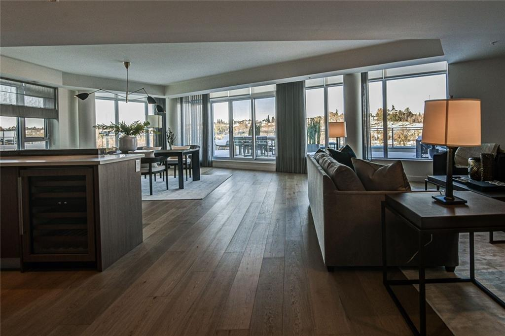 Be the first to live in this spectacular penthouse located in prestigeous Eau Claire. Enjoy endless 360 degree views of the river, mountains, and downtown skyline. This massive penthouse has the entire top floor with 2400 sq ft of living space and boasts over 1300 sq ft of exterior terrace and roof top patio! Gourmet kitchen with top of the line appliances and quartz counters. Hardwood, marble and procelain floor make this penthouse pure luxury living. There are 3 bedrooms,  and a large den/media room. This building is truly the gem of Princes Island, it is a concrete building of only 5 storeys and will only have 13 discreet owners for this bespoke 13 unit jewel of a building.  Located between Calgary's downtown core and Prince's Island Park, the brand new homes at Waterfront are a great place to call home. Walk to work via the +15 network located steps away or go for a run along the river path and Prince's Island Park. This space was created to impress
