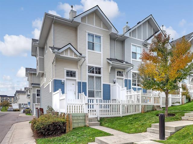LOVELY UPGRADED END UNIT WITH A DOUBLE GARAGE!  This spacious home offers a rare 12? ceiling floor plan & loads of natural light on a quiet interior corner of the complex & easy walking distance to parks, pathways, schools & shopping on High Street in McKenzie Towne.  The main level has a very comfortable living room, a large kitchen with stainless appliances & additional built-in cabinetry, bright central dining area & a half bath. The upper level has 2 generously sized master bedrooms with 4-piece ensuite bathrooms & walk-in closets.  The lower level consists of a large storage area, laundry room & direct access to the double attached garage.  Additional features include a lovely fenced ?front yard? area facing a green space with a concrete patio, newer upper level laminate, Maytag laundry pair & garage door all installed in 2016, ceramic tile & iron railing upgrades, upper level storage cabinet, south-facing BBQ balcony just off the kitchen great for year-round grilling & more.  Welcome Home.