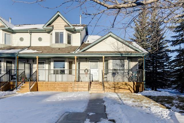 Don?t miss out on this GREAT townhouse in desirable Hidden Valley in a sought after complex. You will love the new front VERANDA. This BEAUTIFUL END unit has a WALKOUT on the 3rd level. The main floor has a spacious living room with a BAY window. The kitchen has VAULTED ceilings, STAINLESS STEEL appliances, plenty of cabinets and there is an adjacent dining area. Upstairs you will find a master bedroom with a WALK-IN closet, another bedroom and full bathroom that has been UPDATED with a tub and a SEPARATE shower. The 3rd level WALKOUT is finished with a large living/family room with a cozy FIREPLACE and a den area. The 4th level is a wide-open space and has plenty of room for storage.The roof is newer. Close to schools, shopping, transit and more!