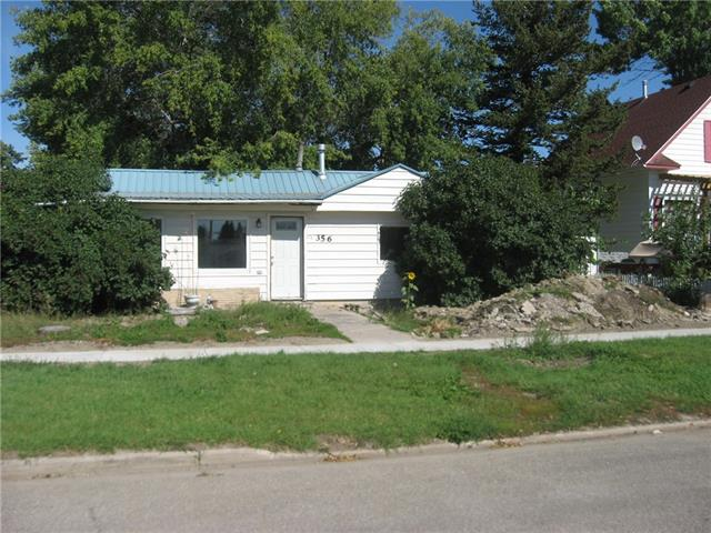 Older home 2 bedrooms, 2 space heaters , in need of upgrading, front yard in need of repair as water line was upgraded . Not that interior needs some upgrading   nice sizedshed in back yard , Car port in  rear of house . Priced to sale .