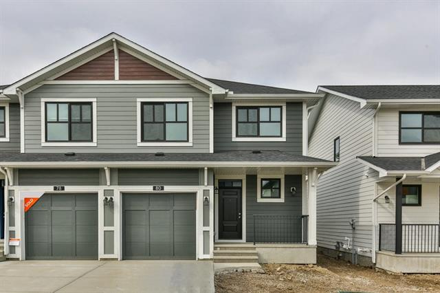 Quick possession home! This is a unique opportunity to move into a new section of an already established community. Excellent accessibility to major roadways, the airport, downtown, Nose Creek Sports Complex and all amenities. This unit comes with an outdoor parking pad located by the park and forms part of the title. Steps away from the pond. This Orchid model by Cedarglen Homes is fully developed with 4 bedrooms and 3.5 baths. Incredible main floor open design. Loads of counter space with an island and extended snack ledge. A spacious eating area opens to a concrete patio. Upstairs Laundry, Impressive 5 pc ensuite bath plus a 5 pc main. Fully developed down with a large rec room, bedroom and full bath. Stone countertops. Beautiful laminate flooring throughout the main with tile in the upstairs laundry and baths. Easy to show, Call now to view!