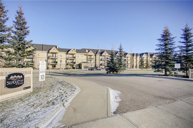 """Top floor within 18+ adult building """"Silhouette"""" which has substantial exterior upgrades recently. This Upgraded 2 bedroom apartment features 9' ceilings, generous room sizes, gas fireplace, in floor heat, Granite kitchen counters, Brazilian Cherry flooring and tile throughout, Silhouette blinds in living room, air conditioning, in suite laundry and large Storage/Den, Common Theatre entertaining room with kitchen and billiards table down the hall, main floor well equipped exercise room with hot tub, steam shower and courtyard, underground titled parking stall right next to elevator, storage locker and access to common car wash. Note! Listing Realtor related to owner"""