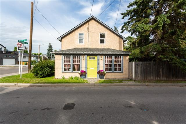 """This 1906 Home is a Sunny Oasis ~ Minutes from downtown!  This home has charm! Decks~shade~Garden with pond, well-treed retreat in the thick of Inner-city lifestyle in popular Ramsay! The Kitchen is compact with sit-up bar area and a Peaceful very Private outdoor area for BBQ's. Many upgrades over the 114-year life of this character home! The main floor offers an (illegal) Cozy & Modern Suite that is in constant Demand, providing for extra Income, with a private Front Porch and separate entry. The 2-car parking area is fenced. IDEAL for a young couple who work downtown and want Low maintenance. This IS an OLD  OLD house with lots of quirks, leaning walls and a dirt basement, but it will last with maintenance until  You Build a New 3 Storey home in your Future with lots of balconies and/or rooftop garden and  capture the """"WOW WOW WOW"""" City & Elbow River Views! Have fun here until you can build ~ your friends will be jealous!  Save Money ~just walk to downtown Calgary along the Elbow&Bow Rivers."""