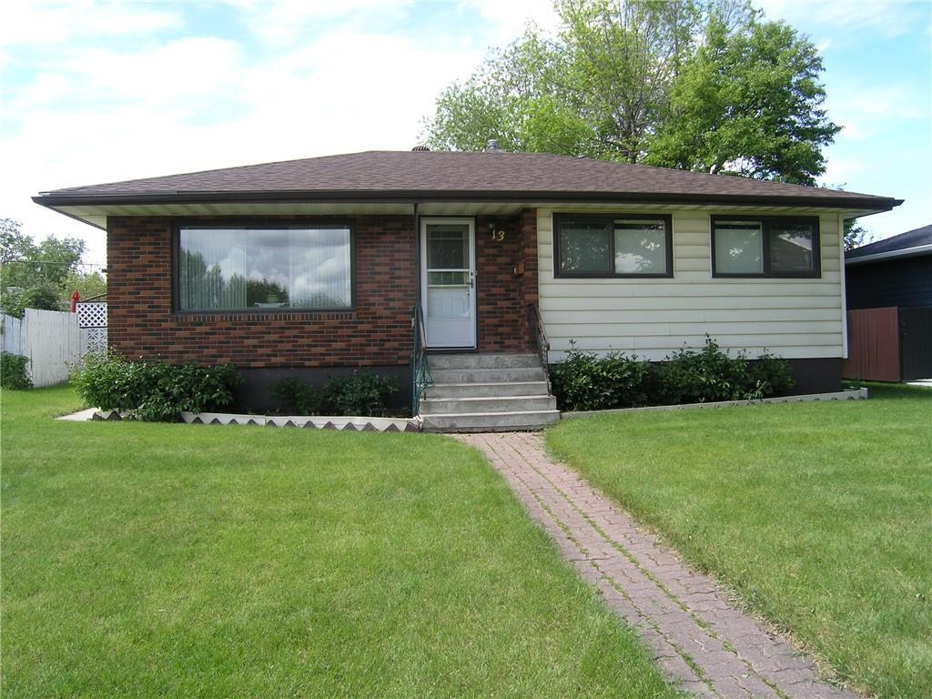 This 1125 sq ft bungalow with a fully finished bsmt of 897 sq ft has 3 bdrms up & 1 bdrm down.  There are 2 full baths & it was built in 1955.  The lot is 59? x 103?.  The kitchen is open to the sunroom/dining room that is 16?2?x11?4? with radiant heat panels in the ceiling.  The bsmt contains 1 bdrm, 1 full bath, a large games/family room & a large laundry room.  The laundry room has a laundry chute at the top of the stairs.  There is a playhouse/storage shed in the back yard.  There are hardwood floors in the living room, three bedrooms and hallway beneath the lino & carpet.  There is a detached double garage 24? x 22? with a forced air furnace.  Hot water tank replaced in 2015, furnace in 1991. Shingles on the house were replaced in 2009, garage shingles in 2019.  The fence is in good condition, posts were encased in concrete.  It is across the road from a large green area. The Zoning is R-C2.  The current owner has lived there since 1958 and has looked after the property meticulously.