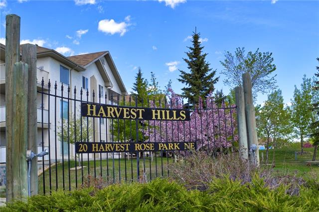 Welcome to this bright, main floor unit in Harvest Hills. (No stairs!!) With 2 large bedrooms, a 4 pc ensuite and a second 4 piece bath, an open concept living room, kitchen and dining room, and a family room with a gas fireplace. Throughout you will find textured ceilings, fluted columns, crown moldings, and shutter blinds. There is a walk out, covered patio. Condo fees include water/sewer and heat. Comes with titled, underground parking stall. With plenty of amenities close by, you won't want to miss this one!
