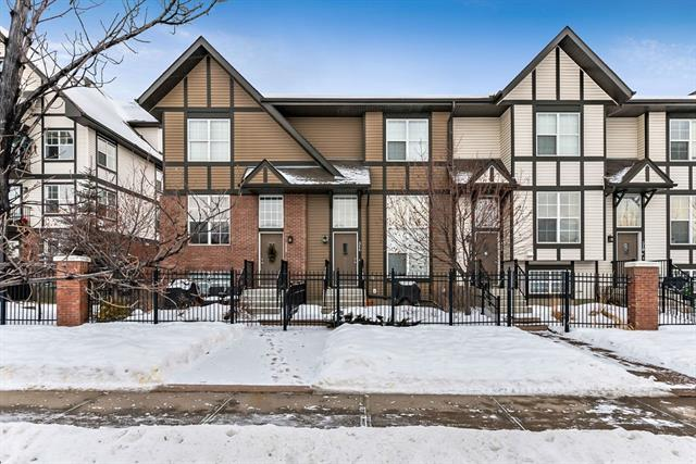 This sweet unit has been lovingly cared for & is in a great location. There is plenty of street parking & access in & out of the community is a breeze. The fenced front West yard is warm & inviting. As you enter you will appreciate the soaring ceilings. The living room has huge floor to ceiling windows to allow the sunshine to pour in. This area has a beautiful built-in shelving unit making media equipment placement easy. Walk up a few stairs & here you will find the open concept kitchen & dining area. There are more gorgeous built-ins in the dining room which gives this pretty home a little extra character. The kitchen features a raised breakfast bar, pantry & a clever BBQ deck. A 2 piece guest bathroom completes this level. Upstairs you will find 2 generous master suites, both with walk-in closets & ensuites. This layout works perfect for a small family, guests or a roommate. The basement has plenty of storage & large laundry area. A double car garage makes these cold snowy days a little more tolerable.