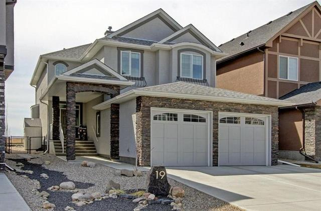 Car Garage! Perched on the Ridge overlooking Fish Creek Park/Bow River Valley w Spectacular Mtn Views! Super easy access off Deerfoot & new commercial site is an exceptional feature.. This beautifully crafted home is loaded with upgrades & has 3512 sqft of quality living space (incl. full basement dev) Engineered hdwd on the main & upper floors with tile in the upstairs laundry and baths. Rated high for energy efficiency with lots of 'think green' upgrades: 2'' extruded polystyrene insulation under the basement slab, polyethylene foundation wrap, 200 amp service, Kinetico soft water, triple pane windows w/Solar shield on the south side, & spray foam insulation on the exterior walls. Granite counter-tops in the kitchen & baths! Main floor Den. 4 car garage w one bay converted into a workshop. Beautifully landscaped with in-ground sprinklers and more. Home has been masterfully upgraded w/Custom Wine Cellar, infinity FP & stone wall plus a wine tasting room & Bar! Awesome home!