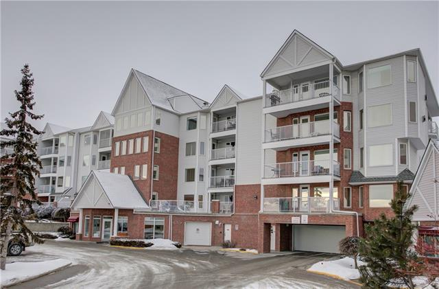 Incredible price and opportunity to buy a large, (over 700 square feet) one bedroom apartment in the sought after community of Hawkwood. Not often can you buy a condo this clean in a quiet, adult building. It's close to Crowfoot Centre, YMCA, public library and a C-train station to take you downtown. This vacant condo has one of the largest balconies in the complex. Lots of room for family get togethers, full table and chairs and has a gas line for a BBQ and a heater. This 55 plus building has a wood work shop int he basement and a full club house building for social get togethers and a nice place to read and meet your neighbours. Inside this condo you will love the bright, open plan, gas fireplace that warms the large living room and the ample sized master bedroom. You have your own titled parking stall (#37) and private locker (#60) in the basement. This is one of the best buys in the northwest for a one bedroom of great size. Immediate possession is possible and the building is financially strong.