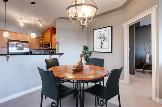 Vacant, very easy to show and quick possession possible! Live among the tree tops in this 2 bedroom PENTHOUSE condo in beautiful Discovery Ridge. Situated in a prime location overlooking the 93 Hectare environmental reserve of Griffith Woods, this location offers the perfect space for all those urban outdoor enthusiasts. The open concept kitchen offers beautiful brand new Italian GRANITE COUNTERS, new PENDANT LIGHTING, stainless appliances, eat-up breakfast bar and good cabinet space; and opens on to the living/dining area that features a natural gas FIREPLACE with lovely stone surround. Spacious master bedroom has huge walk-in closet and private ensuite w/ SOAKER TUB and separate shower. New granite counter tops in both master and guest bathrooms. Other awesome features include in-suite washer/dryer, balcony w/ bbq gas line, and secure indoor parking (1 titled stall in underground parkade). Condo fees include ALL utilities (cable/internet on own) to keep costs low as well as an on-site fitness centre.