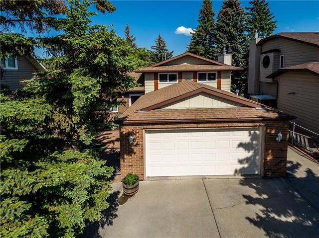 Welcome to 4 Glenhill Dr! Incredible home backing onto Cochranes famous pathway system. Quality renovations are found throughout. Shingles replcd 10yrs ago, triple paned windows on 3floors, furnace replcd 2003, hot water tank replcd 2008, pot lights, LED lights in stair risers, hardwd flrs, pot lights, paneled doors, composite deck in the garden, the list goes on. Kitchen features large island w/cabinets, drawers, topped w/granite, and is a perfect area for casual entertaining. Beautiful white cabinetry, quartz countrtps, S/S applcs, pantry, over-looks the garden. Master bedroom features updated 3pc ensuite w/over-sized tiled shower, & built in california closet & wardrobe. 3level is beautifully updated w/gas frplce, built-in bar w/feature lights, vinyl flooring, laundry, 2pc ensuite, gorgeous timber beams. Garage is drywalled, insulated & heated. Plenty of room of the 29ft driveway. Property is surrounded by mature trees. Book you showing to see why Living in Cochane is Loving where you Live!