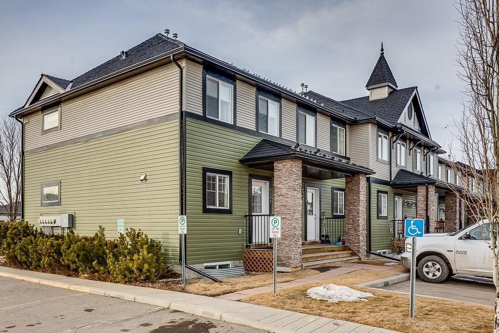 WELCOME HOME!  Available for QUICK POSSESSION!  Found in one of Airdrie's most popular communities, this Stylish END UNIT Townhome has been Updated with FRESH PAINT and NEW FLOORING!  With 3 BEDROOMS UPSTAIRS, an OPEN CONCEPT FLOORPLAN and 2 PARKING STALLS, THIS HOME has it ALL!  The Main Floor Boasts Tons of NATURAL LIGHT with a Maple Cabinetry Kitchen featuring AMPLE Storage and Counter SPACE plus an ISLAND with Breakfast Bar.  The Kitchen FLOWS into the Dining Room & Living Room areas and out onto the PATIO to enjoy summer BBQ's with family and friends.  Upstairs features the Master Bedroom with two Large Closets, 2 Large Bedrooms and a FULL 4pc Bath.  The Basement is Partially Finished with the Framing Completed Ready for a Rec room or Another Bedroom, a Full bathroom and a Laundry room; Ready for your finishing touches.  This well-maintained complex is close to many great schools, playgrounds, pathways and shopping.  A fantastic and affordable opportunity to own your own home!! Call today to view!