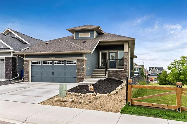 Don't wait to see this Beauty! Visualize the lifestyle this home offers with 1606 sqft on the main floor plus 1444 sqft of developed space in the walkout basement. Start your day in your peaceful master sanctuary including private ensuite while the rest of the family prepares in their own space with additional bedroom and full bath down the hall. Enjoy breakfast while taking in westfacing views of the adjacent park, including mountain peaks to the west. Share these views with your guests while entertaining thanks to the open concept kitchen/dining/living. Check off your to-do list in the main floor office, or use this flex space for your own special use. The main floor also has a mudroom/laundry room off the double garage to complete the package. Imagine the possibilities offered by the developed walkout space with bedroom, full bath, and HUGE recreational spaces including roughin for wetbar, gas fireplace and mounted TV. Carry the party out onto the massive concrete patio and spacious yard.