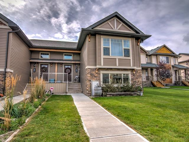 This immaculate 3 bedroom bi-level shows pride in ownership. Open living area on maim with vaulted ceiling, corner fireplace, spacious kitchen with granite counter tops, large island and spacious corner pantry. Dining area opens to a large south facing deck w/gas hookup for bbq. Lower level walkout with large family room, dry bar, bedroom and full bath. Walkout to lower patio, great storage under deck, fenced back yard and gravel parking pad with plenty of room for garage. Property backs onto green space and there is a play ground closeby. This home features plenty of large windows filling the home with natural light. Vinyl plank flooring for easy cleaning. Great new area on west side of Strathmore for easy commute to city.