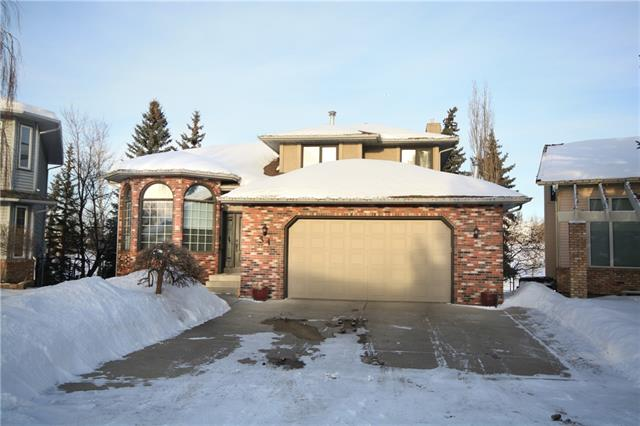 OPEN HOUSE SUN Feb 16 2:00-4:30 Wonderful Family Home.Quiet crescent backing onto golf course. Over 4000 sq ft of living space. Almost 1500 sq. ft. on main floor. Over sized double att. garage. Open plan, 4 bedrooms with vaulted front den/office. Easy access to Deer Foot Trail and all amenities. New 30 yr roof 2008. New glass installed in a number of windows. HUGE master bedroom with spa like ensuite, renovated main bath and 3 more beds up. Vaulted ceilings in living room, fireplace/book shelf feature wall in family room and large eat in kitchen. Amazing views to golf course. Main 1/2 bath and laundry. W/0 basement has large family room, 3rd full bath with shower, INDOOR HOT TUB SPA and Recreation room that could be 5th bedroom. Many upgrades over last few years including new front door, stucco painted, bathrooms upgraded, new sidewalks, deck and patio, New granite counters sinks and faucets. Appliances upgraded. Recent interior paint. Pride of ownership shows. SEE 22 MORE PHOTOS ON WEBSITE