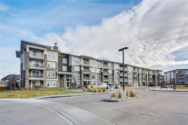 LAKESIDE LIVING AT ITS FINEST. Original owner, Mountain views off the West facing balcony, custom and professionally installed organizers throughout. This top floor end unit only has 2 neighbors. The titled underground heated parking stall is located 10' from the parkade elevator & the unit is located 15' from the top floor elevator, equaling the most convenient combination of home & parking in the entire building! Enter into an open & appealing design w/ a center lifestyle room offering a guest suite to the left & master retreat to the right. The kitchen is well designed & upgraded w/ extented cabinets, quartz counters, a eating bar & stainless steel appliance package. The master retreat boasts a generous size room, walk through dual closets into the 4pc private ensuite. The guest quarters showcases a storage closet & is set steps to the homes second 4pc bath. Enjoy the added benefits of a built in tech niche, laundry room, storage locker & stroll to all the shops & services Mahogany Village has to offer