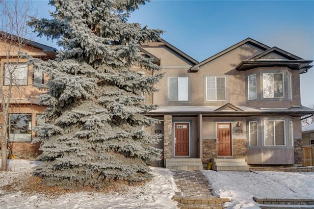 Great value in this 2006 built 3 bedroom home just a stones throw to U of C and 10 minutes to downtown! You are greeted with warm hardwood floors on the main PLUS cozy a 3 -sided gas fireplace that separates the dining room/living room, kitchen has SS appliances, Granite counters, new stove, big pantry for your goods and a 2 piece bath. Stroll upstairs to a VAULTED 2nd floor with a study/computer area, 2nd bedroom with walk-in closet and enuite, then over to the roomy MASTER with gas fireplace, walk-in closet, built-in corner dresser/bookshelves and a 4 piece ensuite. Head downstairs to a 3rd bedroom, 4 piece bath, laundry room and rec room/theatre area. Nice size deck in the back for BBQ's, there's a yard for the kid's and doggie, A/C and a DOUBLE garage!