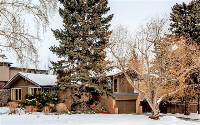 Fantastic location on a QUIET AVENUE in the heart of Riverdale, unaffected by the 2013 Flood. ACROSS FROM A TREED RESERVE which offers 4-season beauty + privacy. Inside the catchment for some of the TOP SCHOOLS in the Province (Elbow Park + Western Canada HS). Amazing parks + an abundance of shops, services + restaurants are also close by. Generous 6071 ft2 lot w/ sunny south exposure. Solid + well-maintained 1956 vintage FAMILY HOME w/ 2749 ft2 of developed living space. Spacious principal rooms w/ park views, woodburning FP + hardwood floors. NEW KITCHEN IN 2003 w/ Denca cabinetry, stainless appliances, Caesarstone counters + large skylight. Top level has 3 BEDROOMS + 2 baths. WALKOUT 3rd LEVEL w/ family room (sliding doors to the yard), spacious laundry + DOUBLE ATTACHED GARAGE. Rec room w/ FP, 4th bedroom + office on the 4th level. GREAT YARD...fully fenced + landscaped. Move in + enjoy -OR- renovate to suit your taste -OR- build your new dream home on this prime lot!