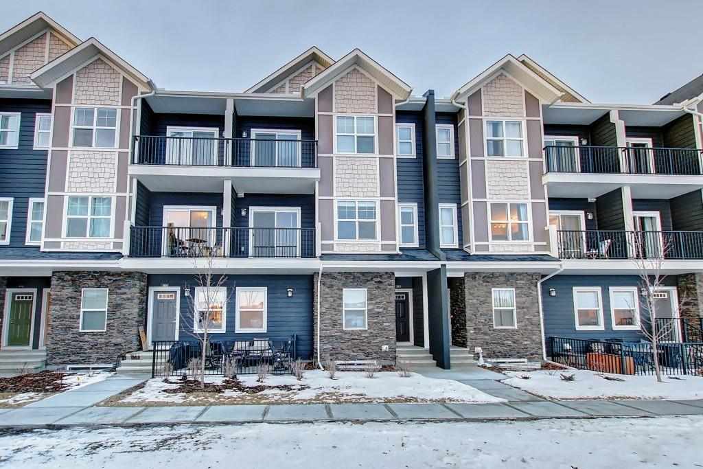 OPEN HOUSE Sunday July 5th 1-4pm ** MOTIVATED SELLER! **PET FRIENDLY COMPLEX. STORAGE LOCKER AND LOW CONDO FEE'S. Beautiful townhome found in the desirous community of Fireside! This 2 bedroom, 1.5 bathroom open-concept home is bright and move-in ready. The main floor features wide plank laminate floors, and a U shaped kitchen with granite countertops and oversized island with breakfast bar. Patio doors off the dining room lead to a balcony with a gorgeous view of Fireside Bullrush Park. Upstairs you will find the master bedroom, with a walk-in closet and a second balcony, and the second spacious bedroom.  The tiled laundry room is also conveniently on the upper floor. Comes with an outside parking stall. Extended warranty on all appliances is transferrable to new owners. Maintenance free living with lots of amenities near by! Close to schools, park and playgrounds. Don't miss out, book a showing today! Property has been vacant since Jan 2020.