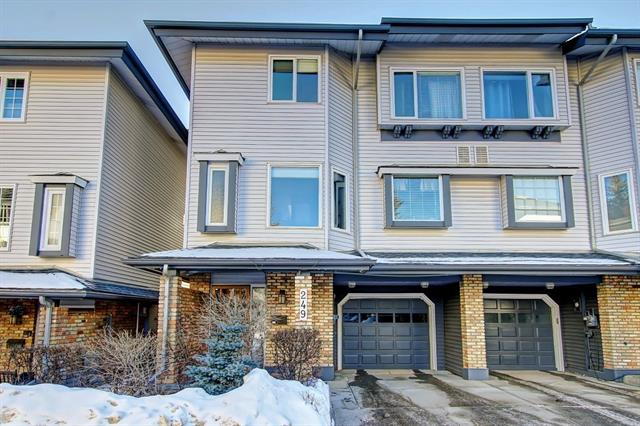 OPEN HOUSE SUN FEB 9 12-1:30PM. This 2 bed + den executive END UNIT townhome w/ garage & driveway in the sought after community of Varsity. 2 min walk to Market Mall, minutes to Brentwood C-train stration & a short walk to the U of C & Alberta Children's hospital. This tastefully updated home offers close to 1,800 sq ft of developed space. The bright kitchen was upgraded w/ extra cabinetry  & newer tiled backsplash.The spacious dining has a rough in for wet bar overlooking the window wrapped south facing living room w/ wood burning fireplace. Outside you have a natural gas BBQ (included) & newer deck. The upper level has a large master bedroom w/ fully renovated ensuite w/ makeup station and walk in shower. One additional bedroom w/ fully renovated 3pc bathroom. Also, a family room/den w/ vaulted wood accented ceilings w skylight & balcony! The grand foyer greets you w/ garage access + storage room & laundry room w/ sink.