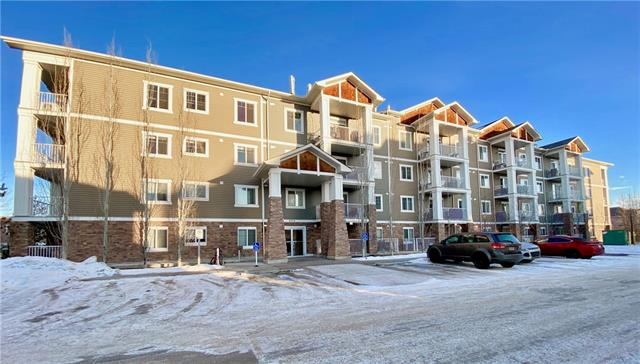 Convenient ground floor unit is within walking distance to multiple schools, green spaces transit, wet lands and Cranston Market which includes, Sobeys, Petro-Canada, Good Earth Coffeehouse, Canada Post, Berwick Public House & much more.  This open concept layout has perfectly situated the 2 bedrooms on the opposite sides of the unit for additional privacy. The master bedroom features a large walk in closet & 3pc en suite. The centred kitchen has stainless steel appliances, timeless white cabinetry, granite counters & eating bar.  A large walk in laundry room has additional shelving for storage or pantry items. The second bedroom, 4pc bathroom, dining room (currently utilized as an office space) & living room are all perfectly laid out to maximize the square footage. The balcony off the living room is spacious & has a gas line.  The unit comes complete with 1 titled underground parking stall and an assigned storage locker which are both conveniently located just steps from the elevator!