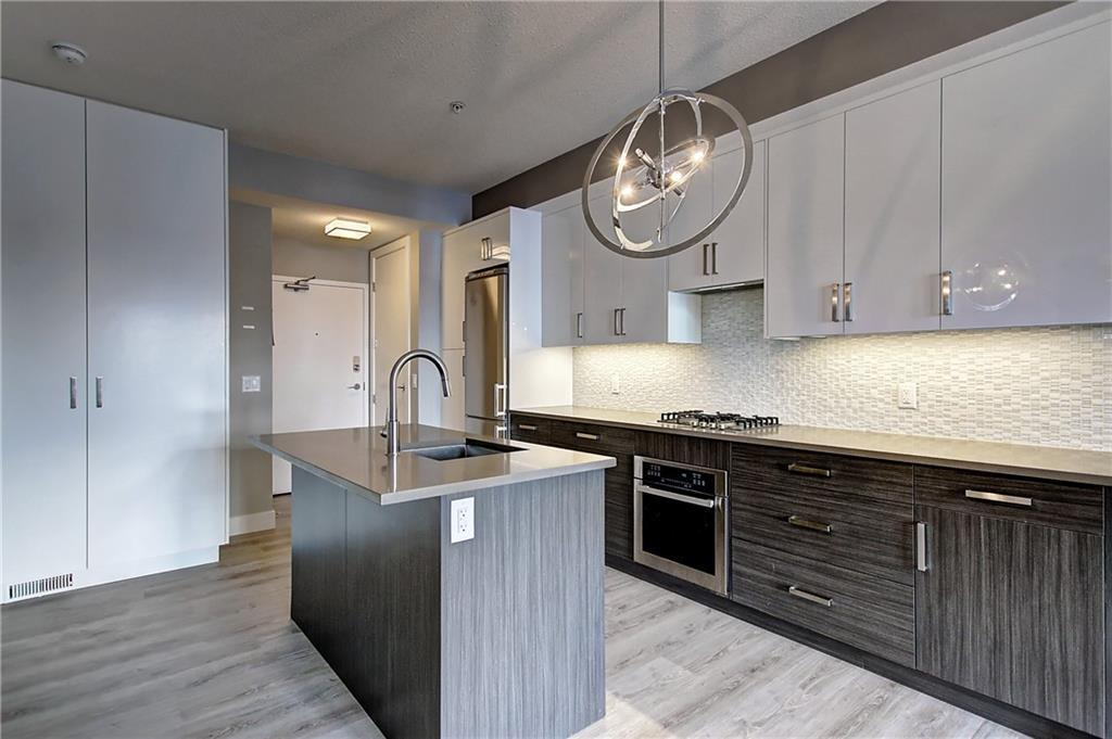 Enjoy the convenience of a maintenance-free lifestyle in the desirable ? Victory & Venture? in the heart of  Marda Loop. This second-floor condo offers 2 beds, 2 baths & secure underground parking. The functional kitchen is showcased by upgraded cabinetry & quartz countertops! The spacious master bedroom comes complete with a large window, wardrobe & 4 piece bathroom. The living room offers an electric fireplace with access to a Romeo & Juliet Balcony. Completing the space is a second bedroom & 3 piece bath. Other features include in-suite laundry, rooftop patio, smart technology building & all amenities including schools, shopping, public transit & major roadways. Book your private viewing today!