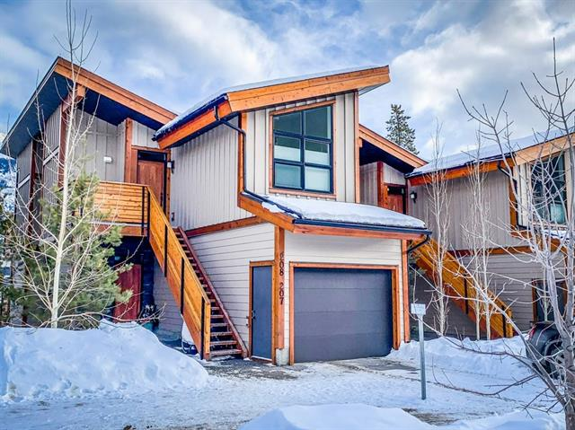 Lovely designed 2 level townhouse with over 1100 sq ft of living space. This unit is perched high up on the ridge, giving you unobstructed mountain views. Master on the main and separate bedroom for the kids/guests on the lower level. Many of the upgraded features include; wood floors, a stunning kitchen complete with stainless steel appliances, quartz countertops and a functional dining area. Tons of closet space and a superior deck with panoramic views, making this mountain retreat a wonderful getaway, a comfortable place to entertain family & friends, but most of all, a place to call home. Find out more about this listing by contacting your associate for a viewing.
