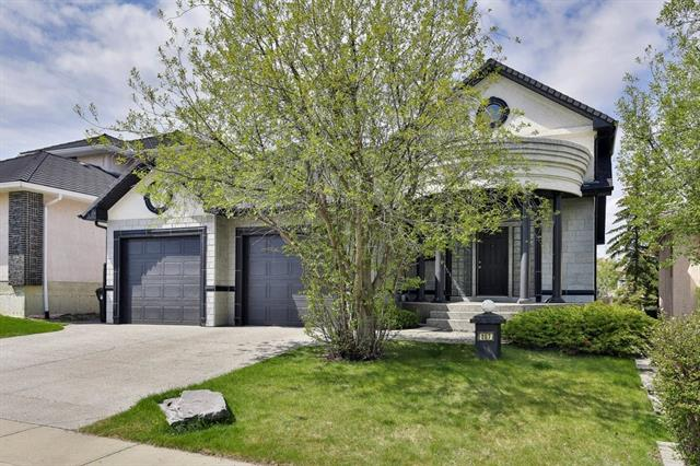 This custom executive home backing onto a green space boasts a total of 4600 sq. ft of developed space with a total of 4 bedrooms & 2.5 baths. The fully developed 3 levels offer soaring vaulted ceilings, skylights, A/C, central vac & sound system. The main boasts a massive foyer w/ filigree staircase, newer paint & hardwood floors throughout including den/TV room , dining rm & living room w/ 5.1 sound system & 2 sided gas fireplace. The chef inspired kitchen features a 9? center island, granite, pantry, tons of custom cabinets & upgraded appliances including a gas range. The top level features a flex rm, study rm & a stunning master retreat w/custom walk-in closet & a stylish 5 pce ensuite. Lower level boasts, 3  bedrms, a rec room/ exercise area/ games rm & family/rec room, 4 pce bath w/steam shower. Alarm is included - no contract. Mature trees a patio area & extensive landscaping finish off this one of a kind Hampton gem?close to schools, transit & amenities... this home has it all!!