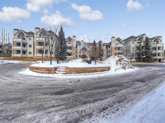 Welcome to Mountain View Terrace, a conveniently located and well maintained complex in the sought after community of Springbank Hill. This home features 3 beds, 2 full baths, over 1430SF of living space, AC and 2 heated, TITLED parking stalls which are located across from the elevator. The main living space is open concept allowing the kitchen to flow into the dining room, through the large living room leading to the large sunny, south facing balcony. The large master retreat is nicely separated from the rest of the unit and is home to a large walk-in closet followed by a spacious well-appointed en-suite. At the other end of the unit you find two more generously sized bedrooms, another full bath and the laundry room. There is unusually ample storage capacity afforded by the oversize laundry room sporting a full closet, an additional storage room off the balcony, and a storage cage in front of one of the parking stalls. This unit is Meticulously maintained, close to transit, C-Train, shopping,