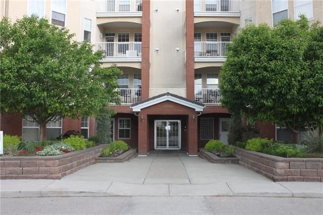 "THIS CONDO WILL BE SOLD 'AS-IS.' ""Beacon Hill"" , 3 minute walk to Fish Creek LRT station! Bright & open 1 Bdrm + Den. 2nd floor location with SE exposure. Large island kitchen with maple cabinetry (new microwave & dishwasher). Large in-suite Laundry/Storage room. Open Living/Dining Room with corner gas fireplace, tile surround & mantle. Master bedroom has 4 pc ensuite. Great building amenities include: Fitness room, Party room, Hobby room, CAR WASH and Guest Suite. Steps to Fish Creek Park walking and bike trails. Close to shopping, theatres and restaurants. Heated UNDERGROUND TITLED parking stall (#15), ASSIGNED STORAGE LOCKER (#77). Sorry, Dogs not allowed"