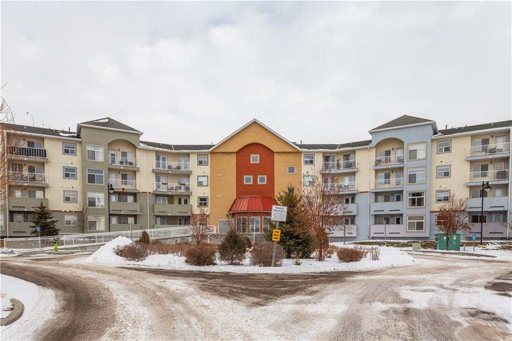 Such a versatile layout for a condo! This unit measures out at over 900 square feet from wall to wall! The layout features two bedrooms and two full washrooms. The master has its own ensuite with a large walk-in closet. This bottom floor unit shows pride of ownership and is super clean. The in-suite laundry is also a bonus! No baseboard heaters to dictate furniture locations, this one has a boiler system with instant hot water that also heats the floors.    The kitchen features a large island design with a sit-up eating bar for extra dining space. This condo comes with a generously sized titled, underground parking stall perfectly located next to the elevator with an assigned outdoor stall. Great price for square footage!