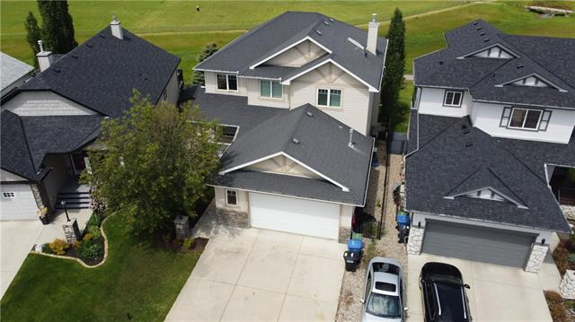 MAGNIFICENT 2,644 SQ FT CUSTOM LASK Built  home looking for new owners. Backs onto acres of fields with km?s of pathways right out your backyard. Fully finished walk out basement. Finished heated garage (24? x 23?) fits a full size truck and has a floor drain. Driveway fits 3 vehicles. Amazing cul de sac location. Great floor plan with massive kitchen and dining area for entertaining. Custom maple cabinetry includes a 12 ft raised breakfast bar. Low E windows. This homes many upgrades makes it an amazing deal and significantly below replacement cost. A partial list of features include beautiful hardwood floors and staircase, built in?s in the office, massive ensuite bathroom, custom walk in mud room closet, in floor heat in the basement just to name a few. Huge partially covered 12ft x 18ft upper deck. Central A/C. Great family home with 3 bedrooms up and 1 down. Enclosed lower patio has hot tub hookups. Make sure you check this one out in person!