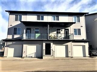 """Welcome to the BRAND NEW JAYMAN """"GRANITE"""" A stunning new approach to Town Home living presenting OUTSTANDING VALUE boasting TOP NOTCH FEATURES for any lifestyle!Granite features a 20,000 sq.ft.green space,complete with playground,BBQ area,pergola & ample green space for families to enjoy.Welcome Home to discover this beautiful MULTI LEVEL TOWN HOME with ATTACHED GARAGE & SEPARATE ENTRANCE boasting an OPEN FLOOR PLAN maximizing every inch offering luxury QUARTZ Countertops through out,stunning Slab Style cabinets & sleek stainless steel appliances.Enjoy 2 MASTER BEDROOMS,2.5 BATHS,In suite Laundry & the lovely generous Balcony creating an additional out door living space.Granite's location has quick access to Stoney Trail,Metis Trail & Deerfoot Trail. Located close to the Calgary International Airport,Costco & CrossIron Mills Mall & future plans to expand the LRT to Redstone. Living in Redstone provides quick access to the Saddleridge YMCA,Don Hartman Arena,and the Calgary Public Library.Discover & Enjoy!!"""