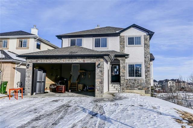 An exceptional view backing onto a ravine! A more than 2500 sq.ft well-designed two storey home with fully developed walkout basement, open floor plan, and plenty of natural light. This 5 bedroom home with 3.5 bath and a double-attached garage is located in a well-established community. On the main level, a bright family room with gas fireplace, large kitchen with maple cabinets, granite counter tops and slate tile flooring, a large study room, a 2 pc washroom, and a spacious mud room leading to the oversized double garage. The upper level has 3 large bedrooms including a master suite with a fantastic en-suite and walk in closet, and a huge bonus room with large windows. The fully finished walk-out basement has a large recreational room, 2 bedrooms, a full bath, and plenty of storage space. The private backyard is fully landscaped and fenced. Easy access to major roads and shopping.