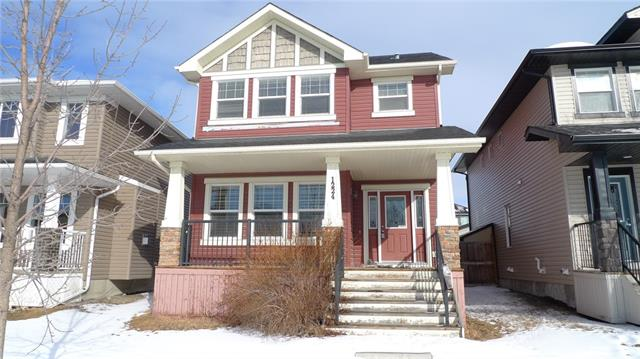 This Amazing 3 Bedroom + 2 Bath Home is located in the desirable family friendly neighbourhood of Ravenswood. Walking Distance to several local schools and shops with easy access to Deerfoot Trail! The South facing main entrance begins with a sun filled front porch. Open and inviting main floor includes living room, dining room and kitchen complete with 9 foot ceilings, hardwood floors and gas fireplace. Second floor has 3 good sized bedrooms. Master bedroom with en-suite bathroom includes large soaker tub, double size shower with a seat and his and hers vanity sinks. Fully fenced back yard compliments a spacious Double detached garage. Book your viewing Today!