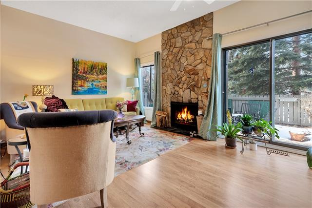 Beautiful quality built and designed townhome in Midnapore. Pride of ownership resonates throughout with granite counters, bright cabinets, and new appliances to make this feel contemporary and modern. The separate dining room overlooks the spacious living area with a wood burning fireplace, perfect for your family to make memories or entertain guests. Upstairs features an expansive master bedroom, a second bedroom and a great bonus area. There is so much open space for you to be creative with on all levels. Outside is a private yard, fenced with a patio area overlooking mature trees and a beautiful greenspace. The townhouse comes with access to the lake and is close to Shawnessy shopping. Call today to get the first look at your future home.