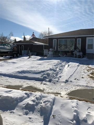 Small town living in the Village of Hussar! This bungalow is located close to school & situated on a FULLY FENCED, 100'x130' LOT. The home features 3 bedrooms and 1 full bath.  Included is a 12'x22' single garage.  The Village of Hussar is located on Highway #561, approximately 30 minutes East of Strathmore; 93 km (58 miles) East of Calgary and 55 km (34 mi) South of Drumheller. Please note: The age of the home is unknown but is believed to be built in the 1960's. Utilities for this property are billed Yearly, Flat Fee. Yearly total $1440.00 Water -$660; Sewer-$480; Garbage -$300. heating is separated from this.