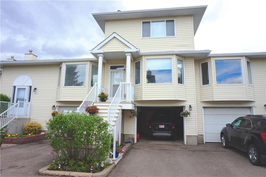 INCREDIBLE VALUE in this TOWNHOME with GARAGE + 2 BEDROOMS AND DEN + 2 FULL BATHROOMS. This is a SAFE AND QUITE site central to Schools, downtown, main roads, and amenities. 