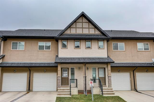 ****ONE OF THE MOST AFFORDABLE PROPERTIES IN OKOTOKS**** What a perfect opportunity to enter the real estate market at a very affordable price. Fantastic 2 storey townhouse in a great location in Okotoks! Are you a family, an investor, first time home buyer? You have to look at this property! Walking distance to a shopping plaza, easy access out of town. Quiet complex! Your future home has an attached garage, good size SOUTH FACING living room(with access to a deck), kitchen, dining room and 2PC bathroom on the main floor; 3 bedrooms upstairs and 2 full bathrooms (master bedroom comes with a 4 PC ensuite and a large walk-in closet). The basement is is wide open for your finishing ideas - a very large space downstairs - perfect for a games or a family room. There is a playground in the complex for the kids to play. It's hard to come across another solid affordable townhome like this one. Come see it before it's gone!