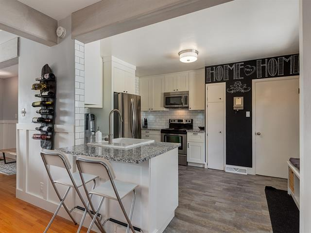 Welcome to this large and bright raised walk-up bungalow, with a non-conforming, illegal suite below. Close to SAIT, Confederation Park, Market Mall, The Children?s Hospital and Down Town, as well as easy transit accessibility right out front, this is the perfect home for a young family, students, or a corporate couple who wants the best of all worlds. This home has seen updates over the recent years, including an open kitchen and entertaining area on the main floor, and a lovely 2 bedroom illegal-unit below. The lot is large and treed, with a double garage & RV parking in the back with 2 additional paved stalls out front. Both levels have completely separate entrances and patio spaces.  Cambrian Heights has remained one of the most popular communities in Calgary, and has continued to see development of new homes and renovations of older homes in the past couple years. An inner city property of this caliber won't last long, call today to book a viewing.